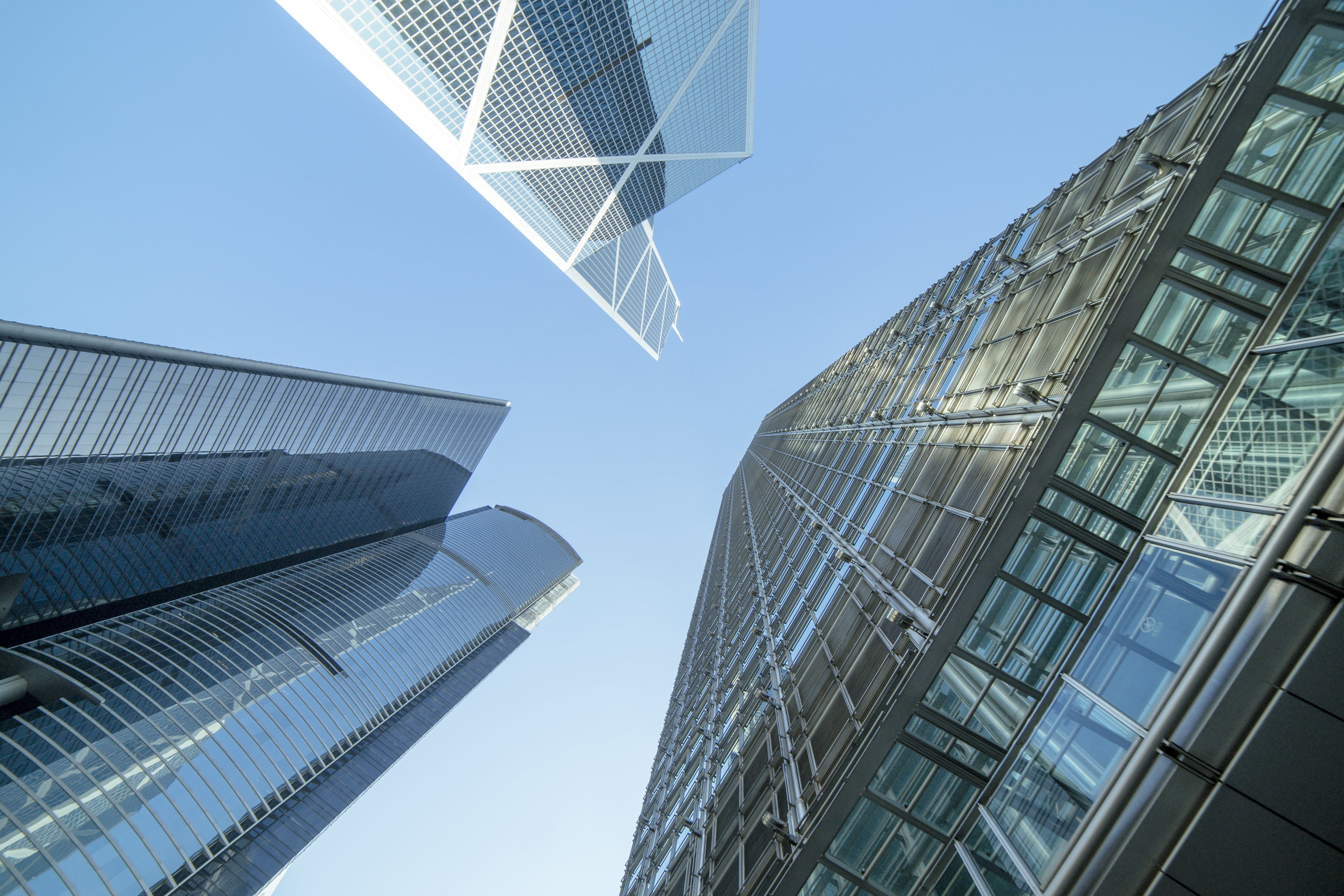Low Angle Photography of Buildings Under Blue and White Sky