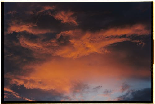 Low Angle View of Orange Clouds