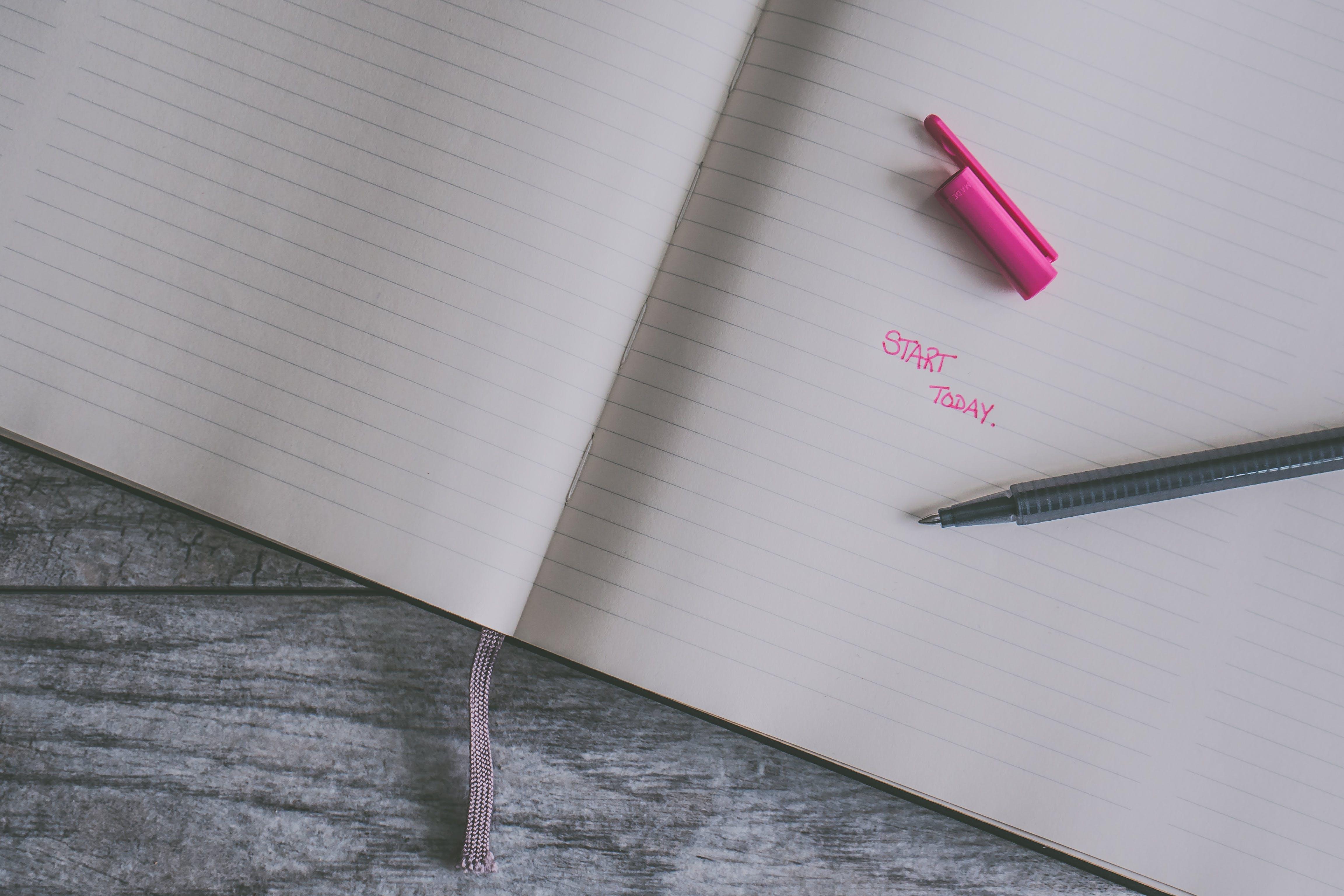 Pink Ballpoint Pen on White Ruled Paper
