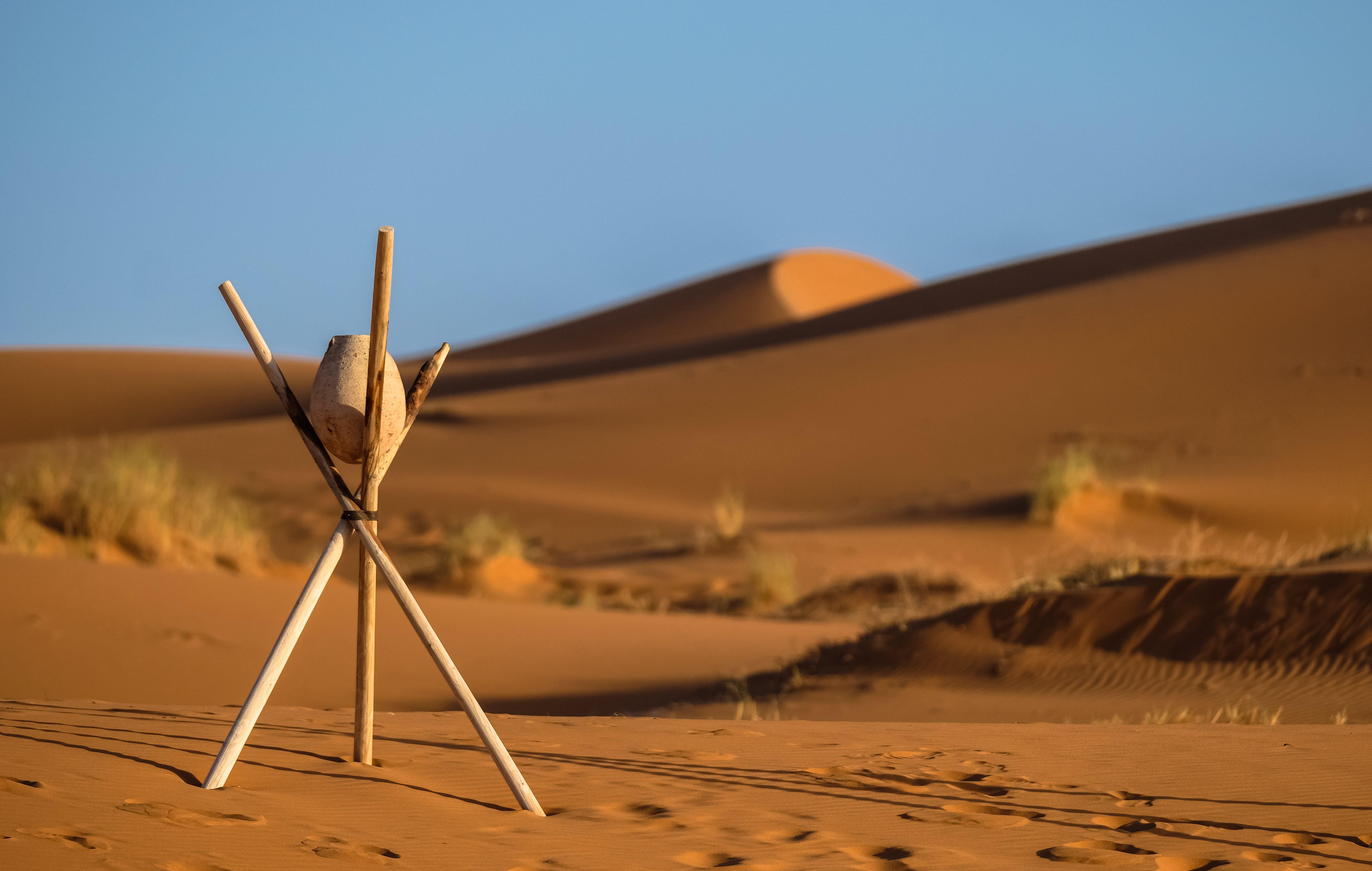 Brown Stone on Tripod Sticks at a Desert