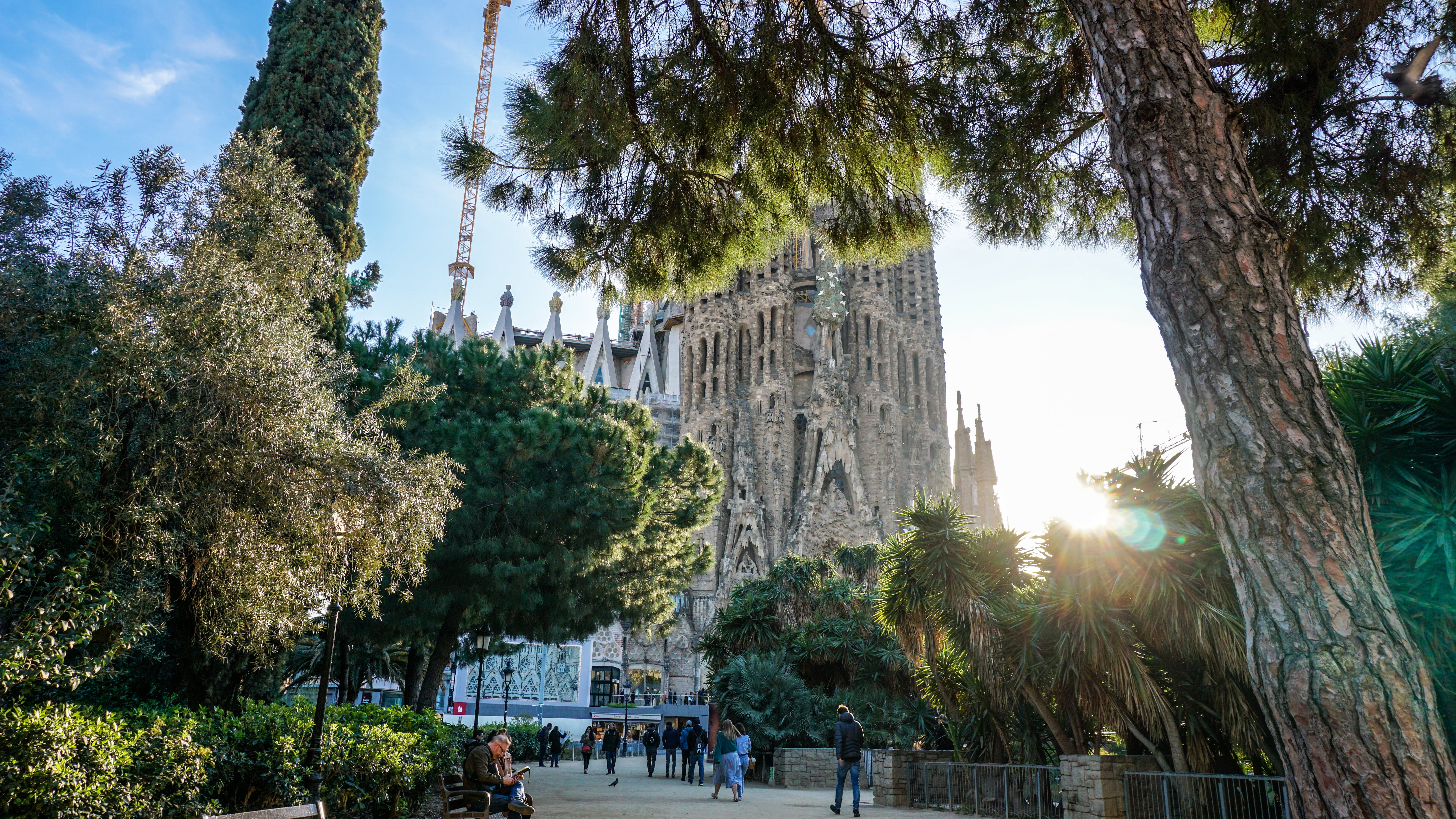 Group of People Walking in Front of Sagrada Familia Cathedral