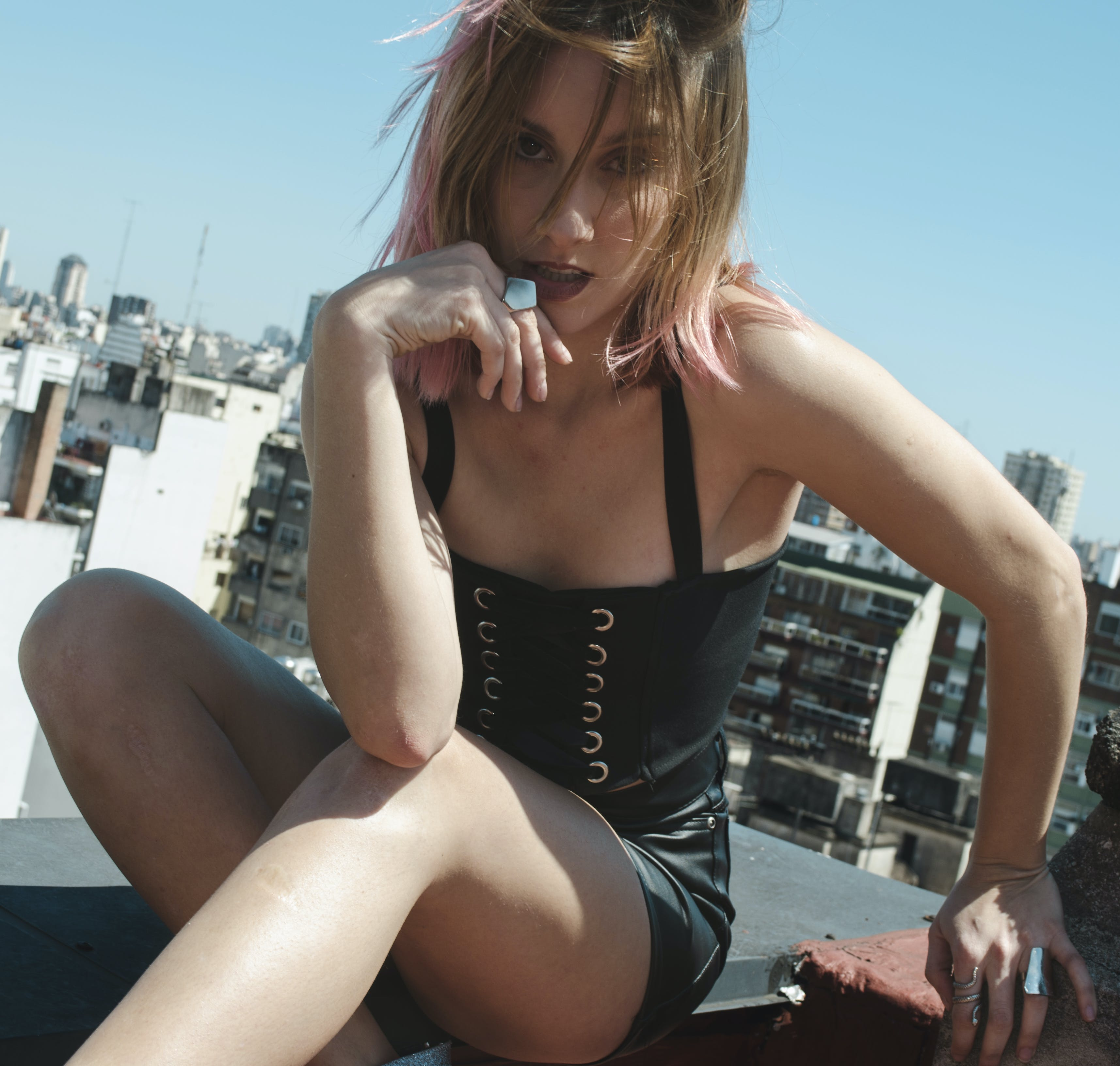 Woman Wearing Black Corset and Black Leather Short Shorts Posing