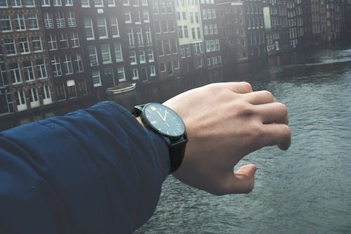Close-Up Photography of a Person Wearing Wristwatch