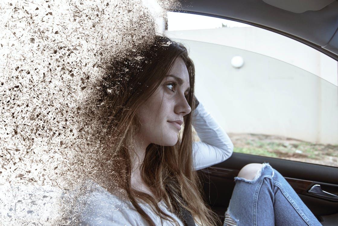 Woman Wearing Distress Blue Jeans Sitting on Vehicle Seat