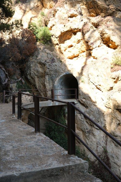 A Shot of a Tunnel Made Inside a Rock