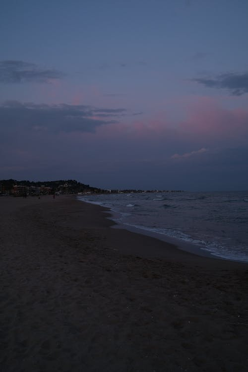A Shot of a CoastlineDuring Dusk
