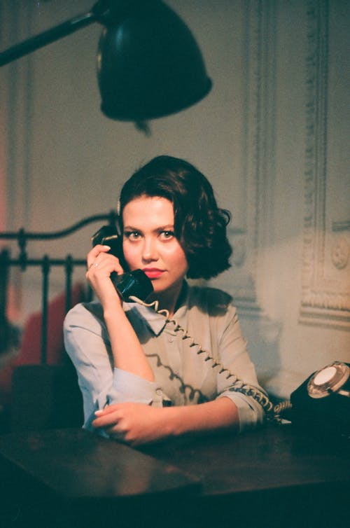 Portrait of Black Haired Woman Holding Handset