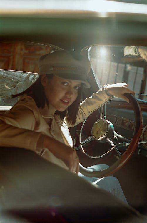 Woman Sitting in Vintage Car