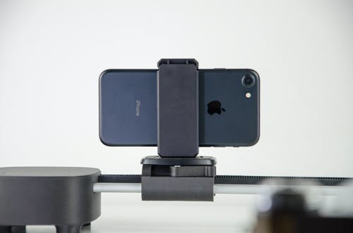 Black and Gray Camera on White Table