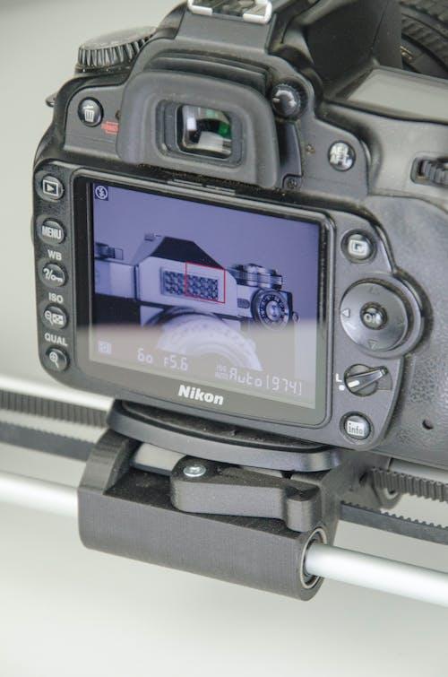 Black Samsung Dslr Camera Showing Music Player