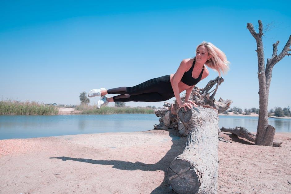 Woman Jump on Tree Log Near Body of Water Under Blue Sky