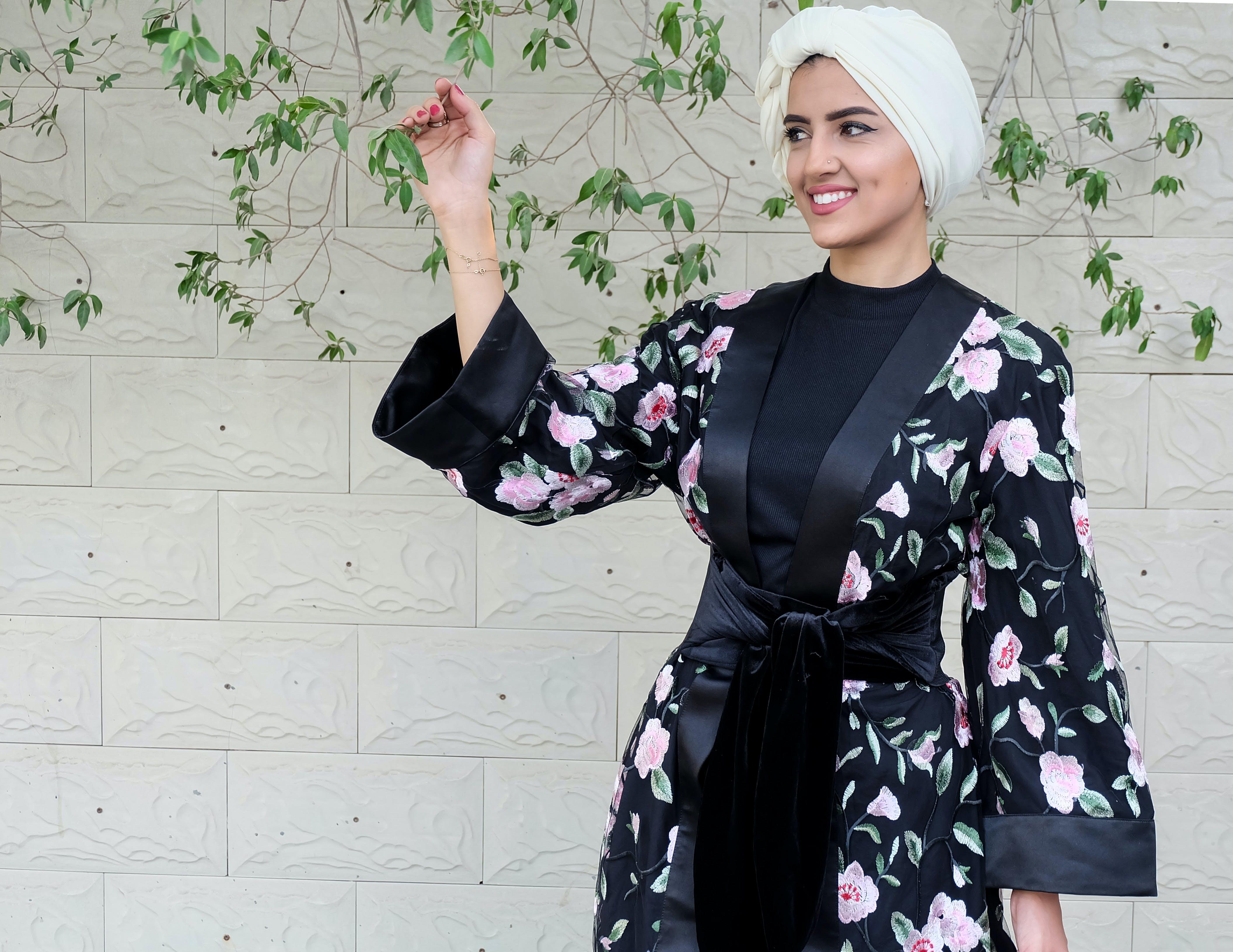 Woman Wearing Black And Pink Floral Kimono