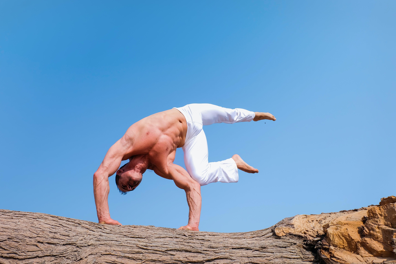 Man Wearing White Pants Under Blue Sky