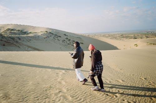Women Walking on Dune