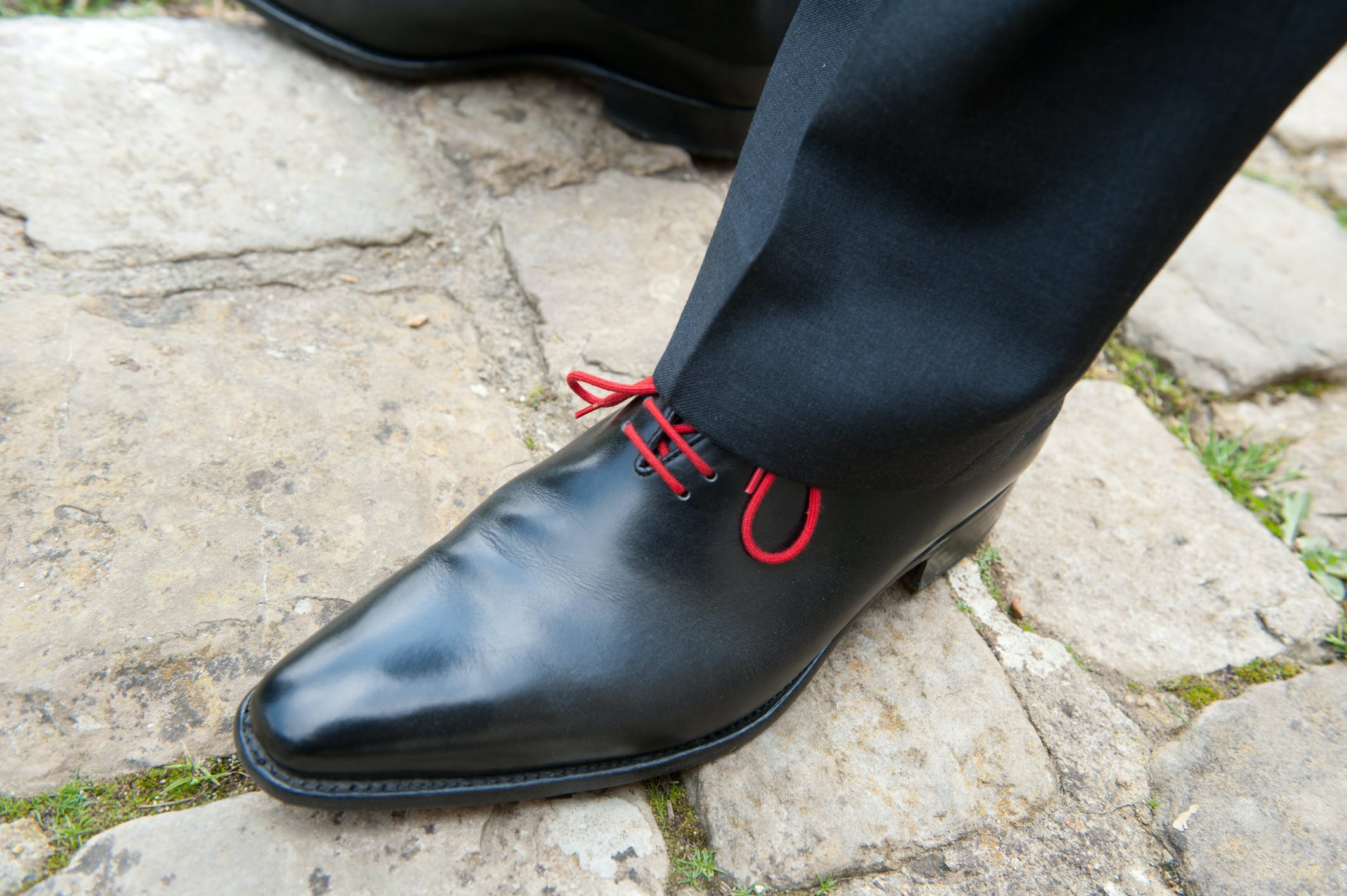 Person Wearing Black Leather Dress Shoes