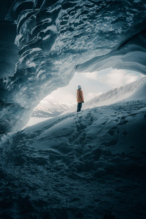 Person Standing next to Glacier