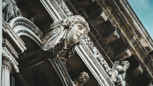 White Concrete Statue of Man