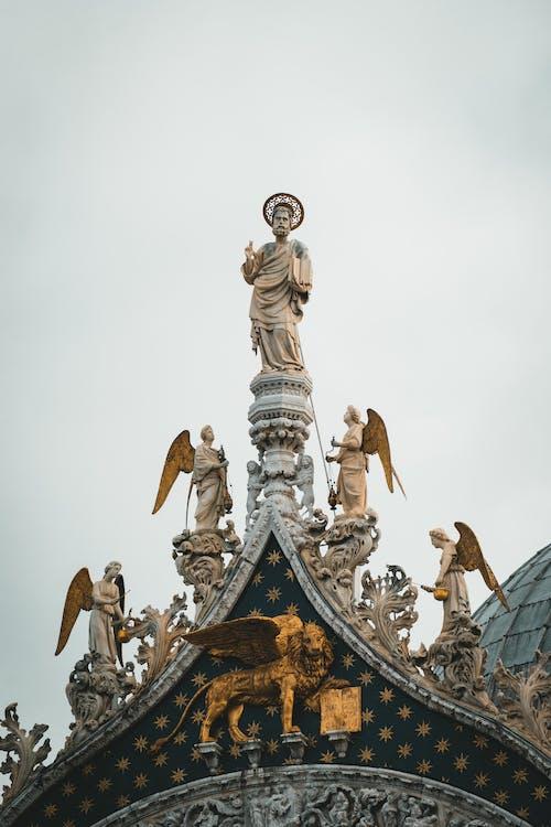 Gold and White Concrete Statue