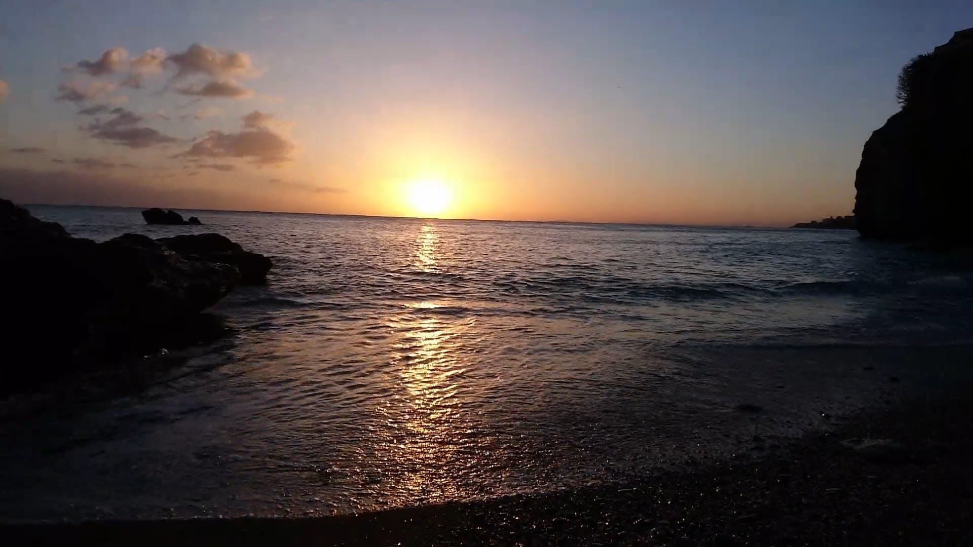 Waves Crashing On Shore During Sunset