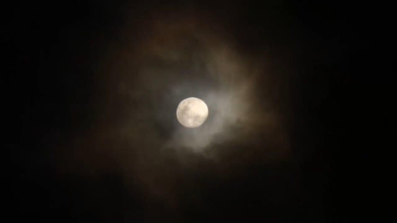 Clouds Passing The Moon