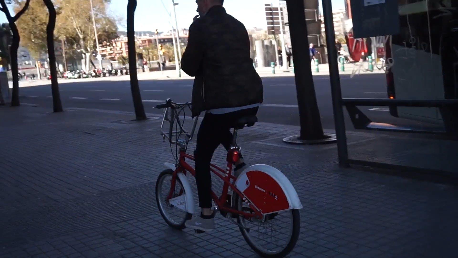 Man Riding On A Red Bicycle