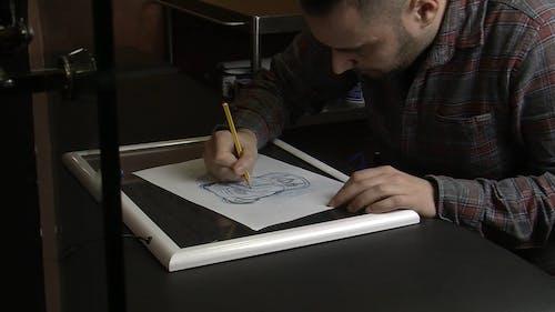 Man Making A Pencil Sketch