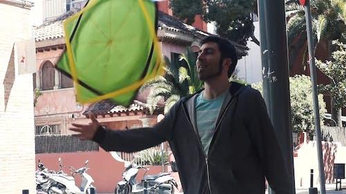 Man Juggling A Mat