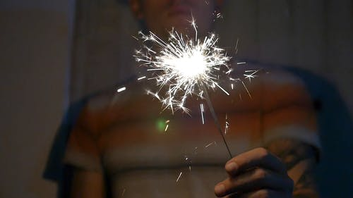 Man Playing with Sparklers