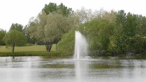 Fountain On A Lake