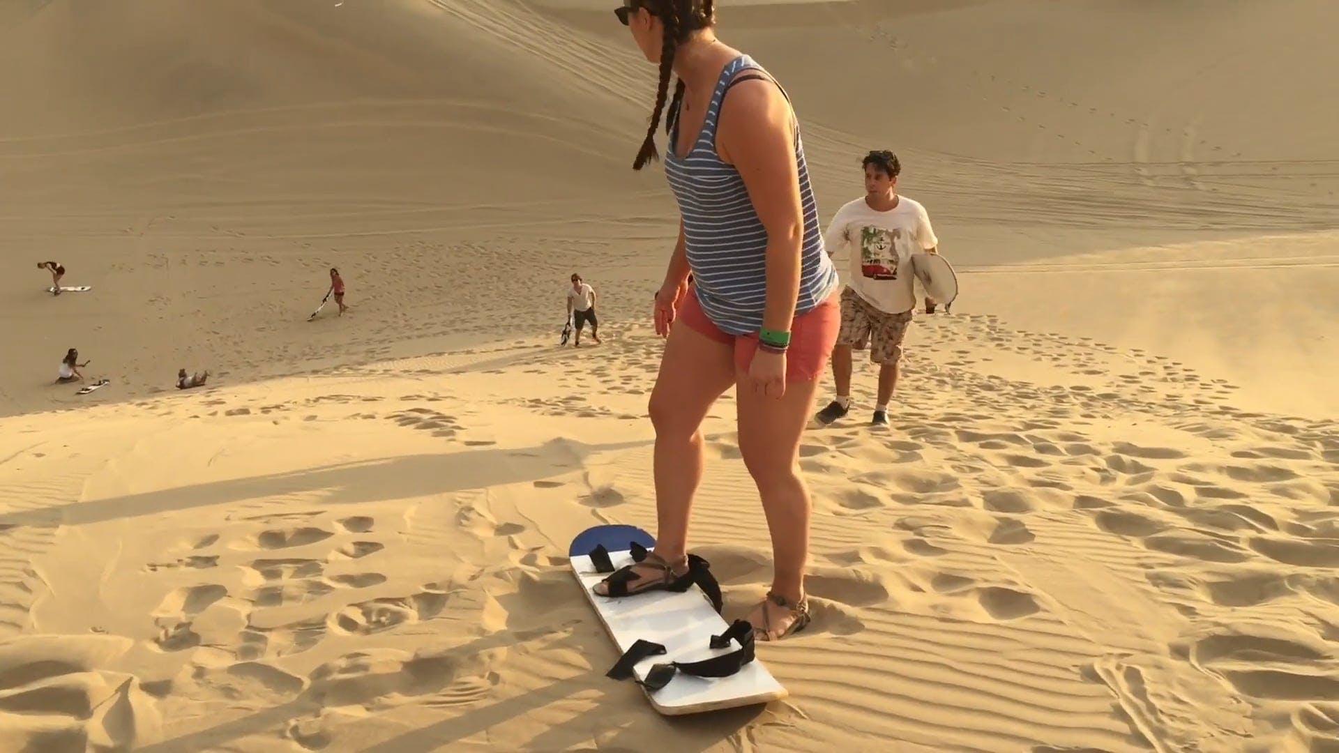 Sandboarding And Sand Sledding