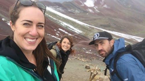 Three People Taking Photo