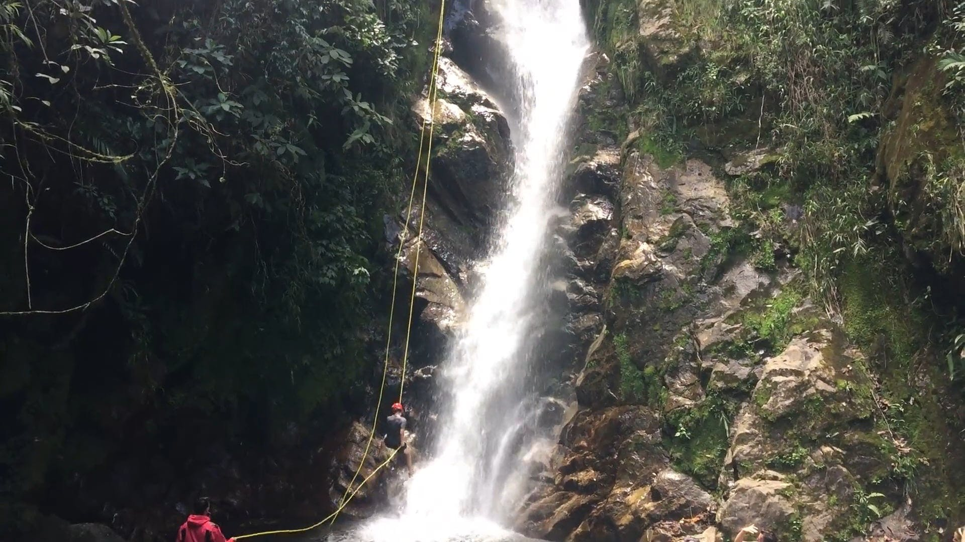 People Going Down A Waterfall