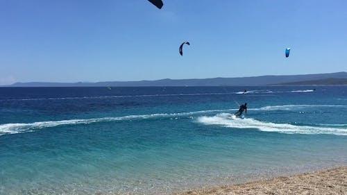 People Kitesurfing