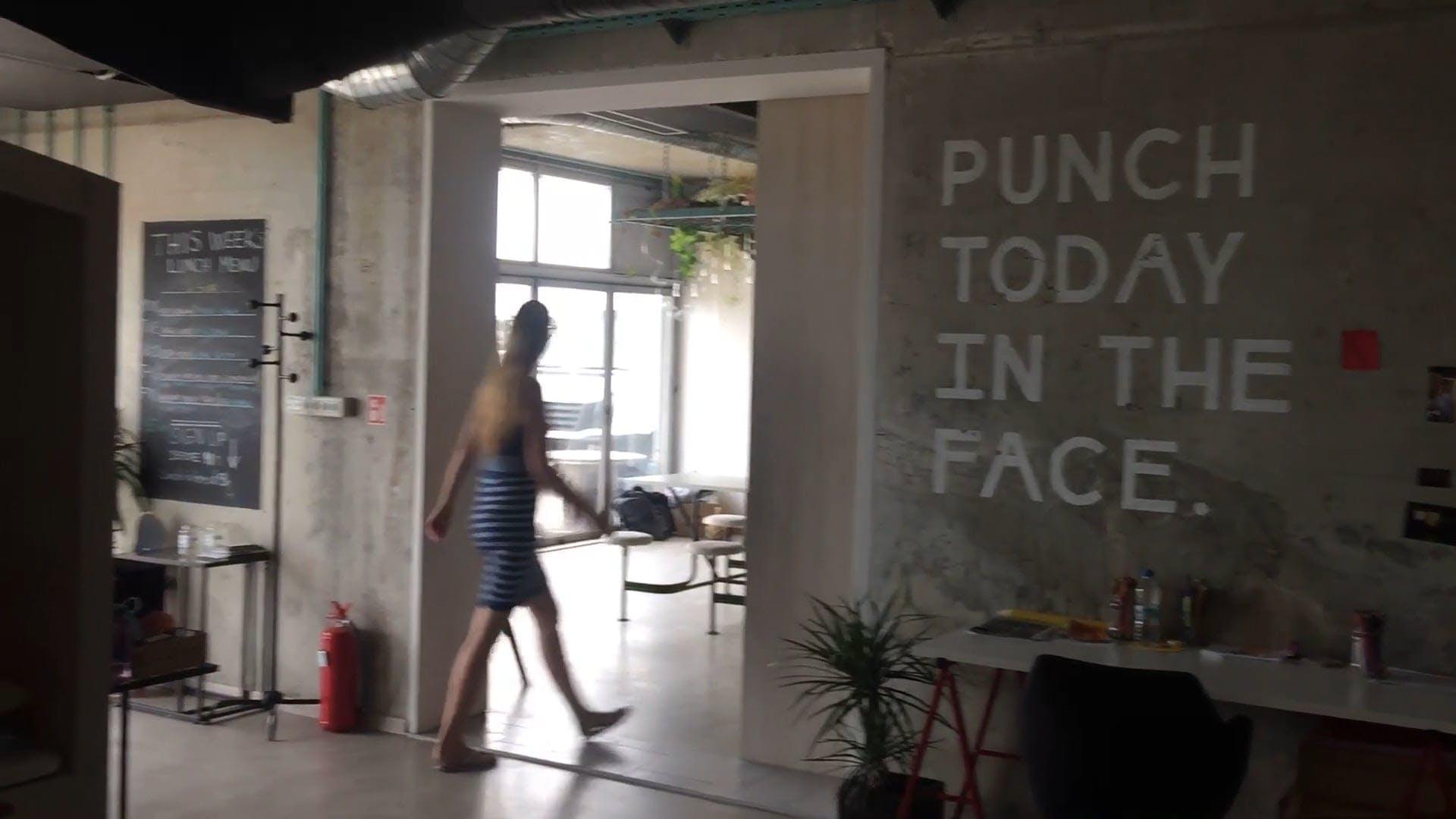 Woman Walking Inside A Building