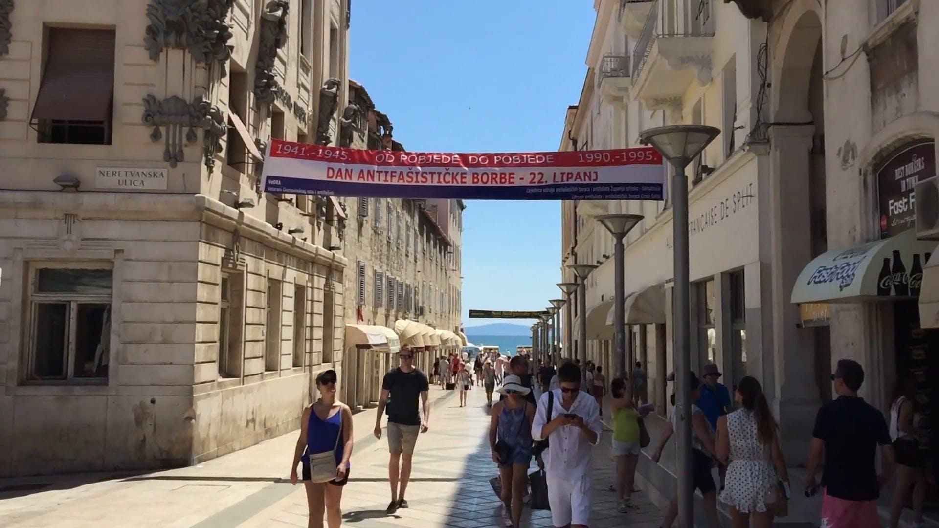 Tourist Walking On The Street