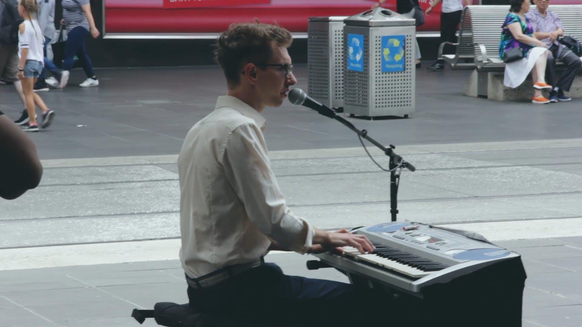 Man Playing Keyboard Along The Street