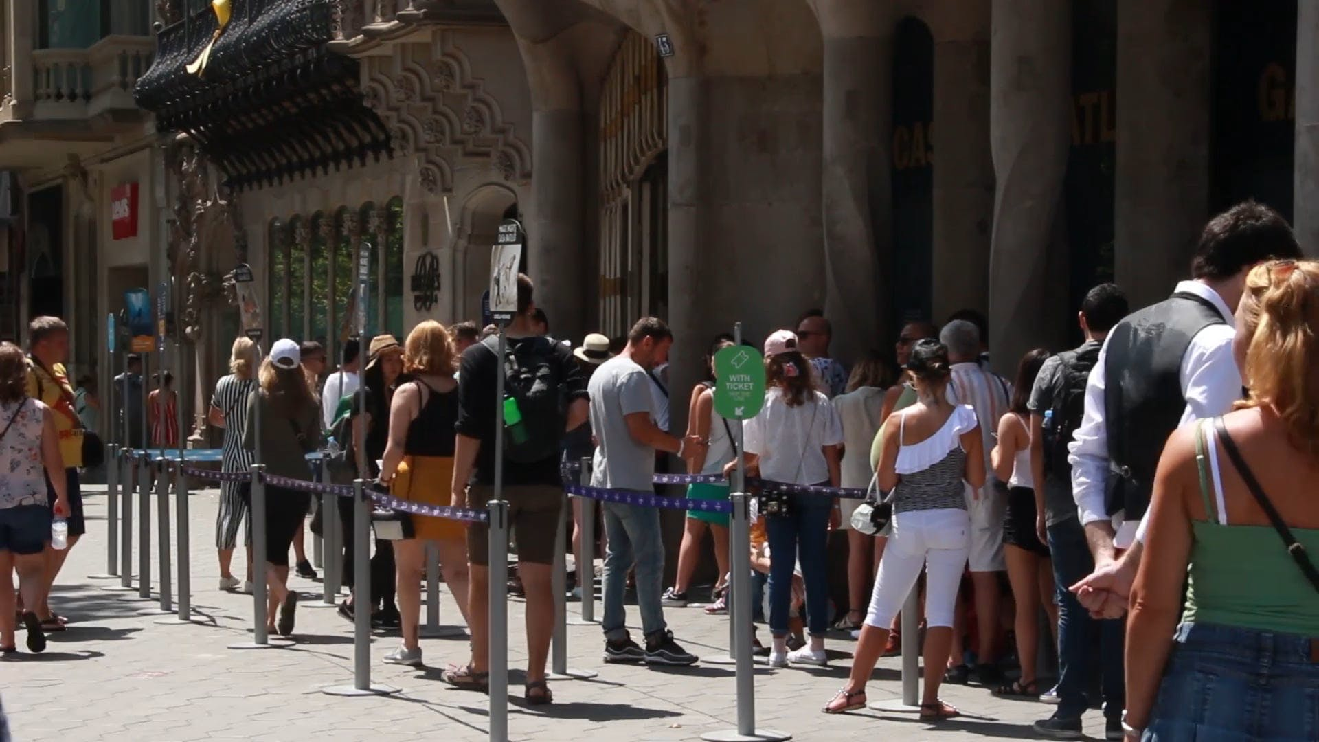 People Waiting Outside A Building