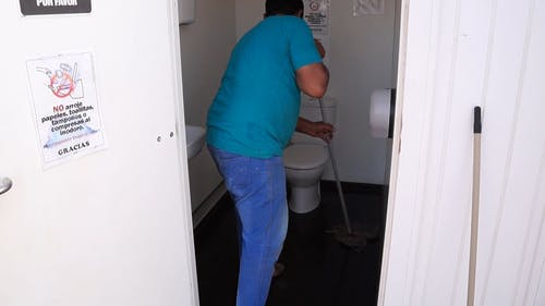 Man Cleaning A Comfort Romm