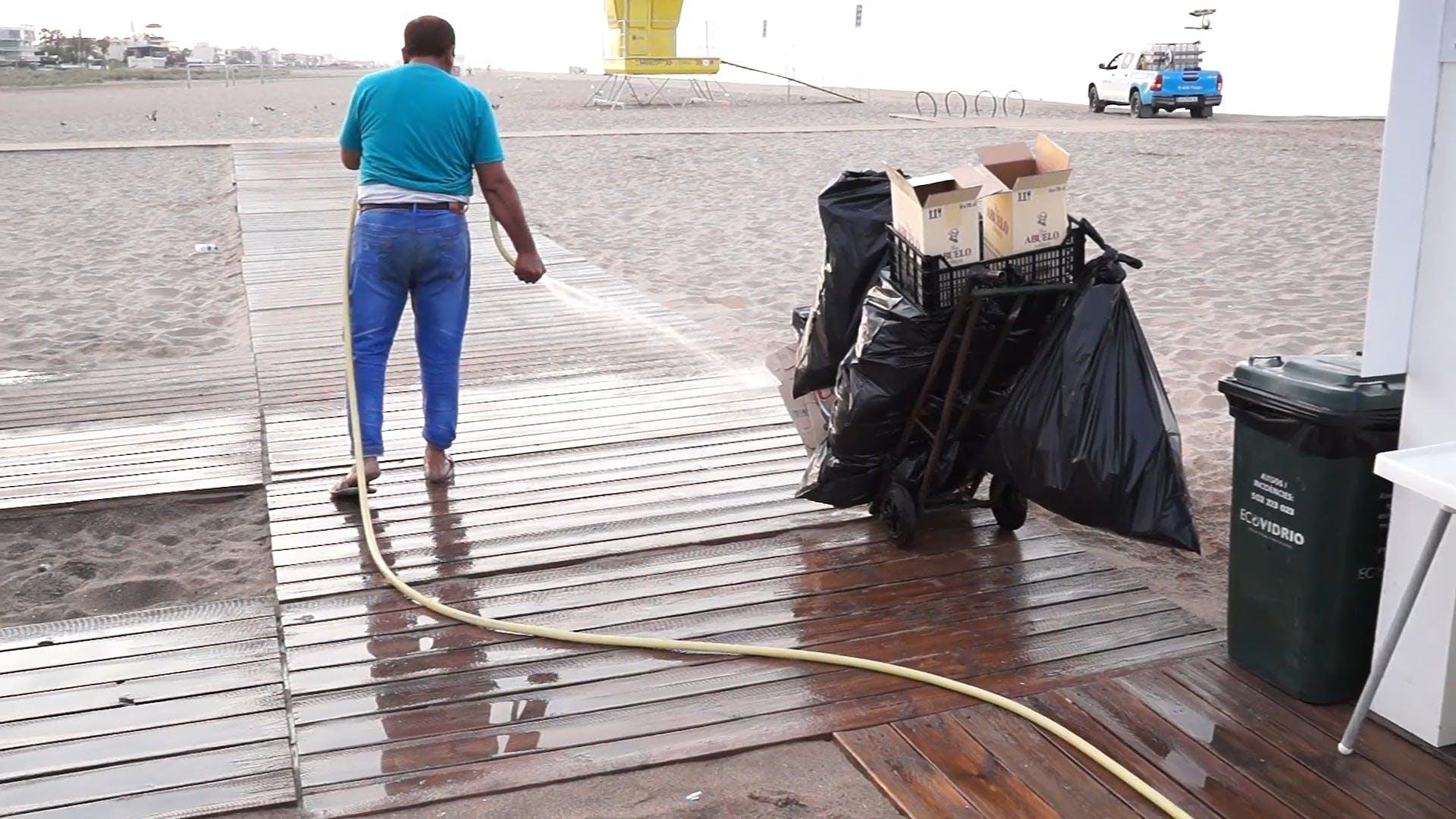 Man Cleaning Walkway