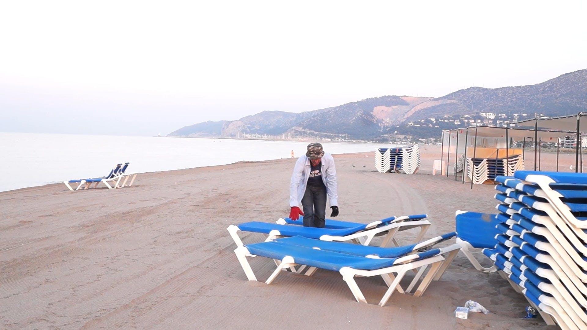 Man Setting Up Beach Chairs