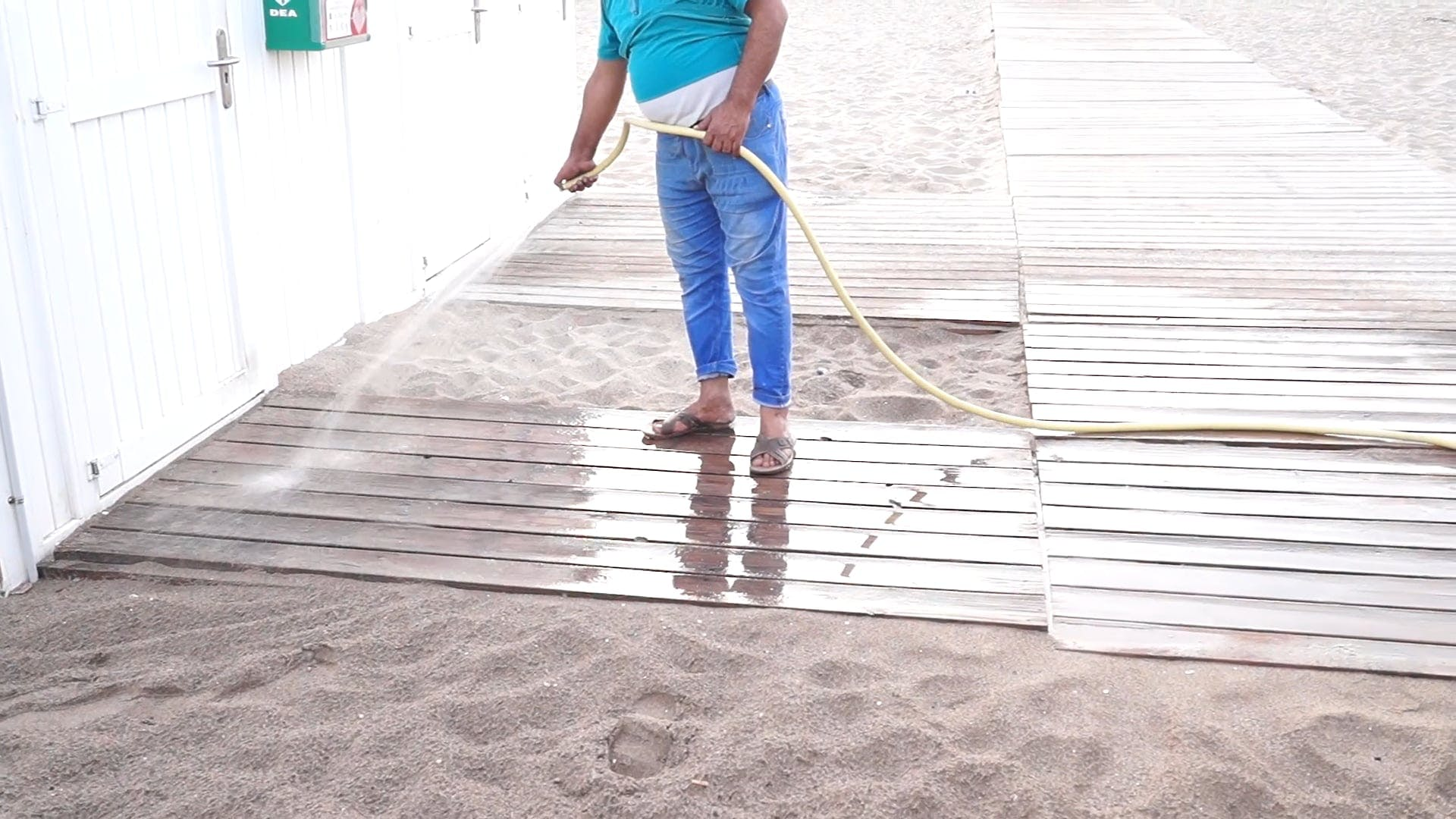 Man Cleaning Wooden Path