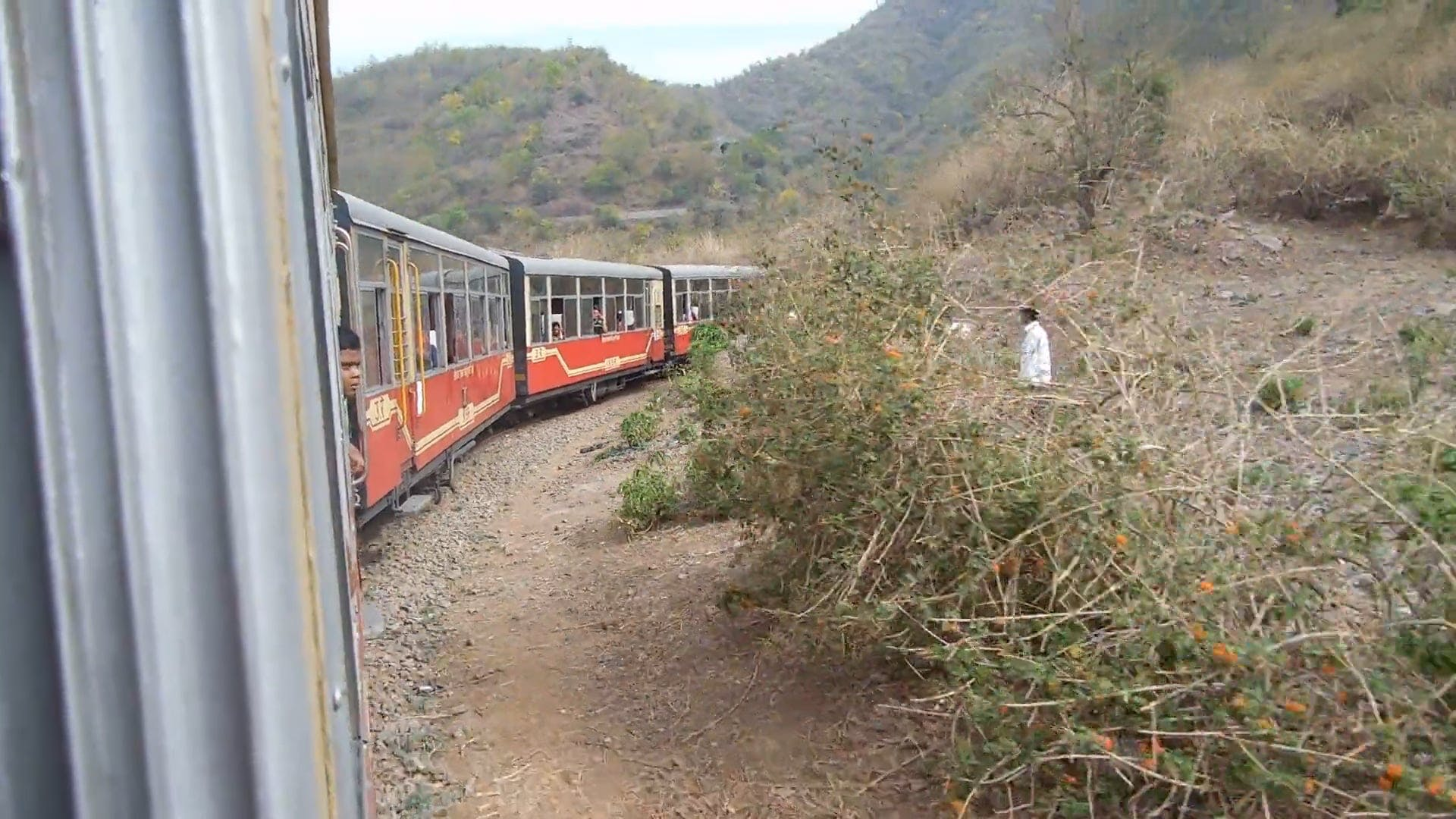 Train Traveling Along The Mountains