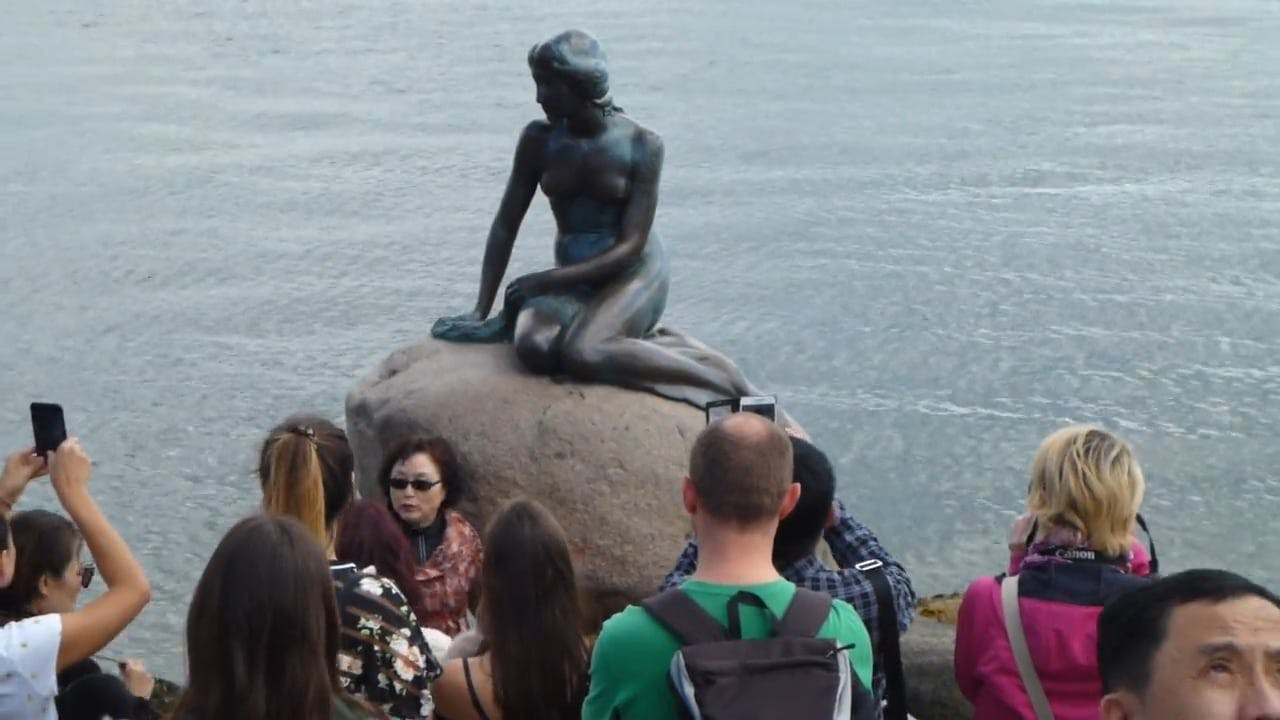 Statue Of A Woman On A Rock