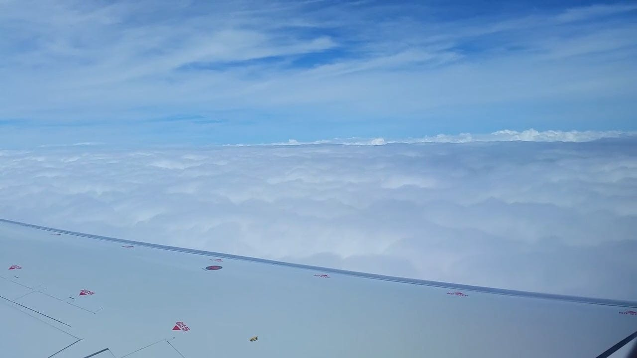 Aircraft Travelling Above The Clouds