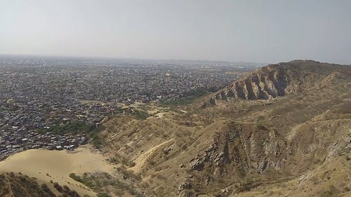 A View Of City And Mountain