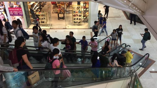People On The Escalators Of A Mall