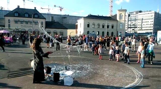 Children Enjoying A Street Performer's Act