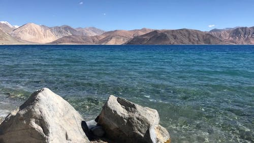 Body Of Water With View of Mountains