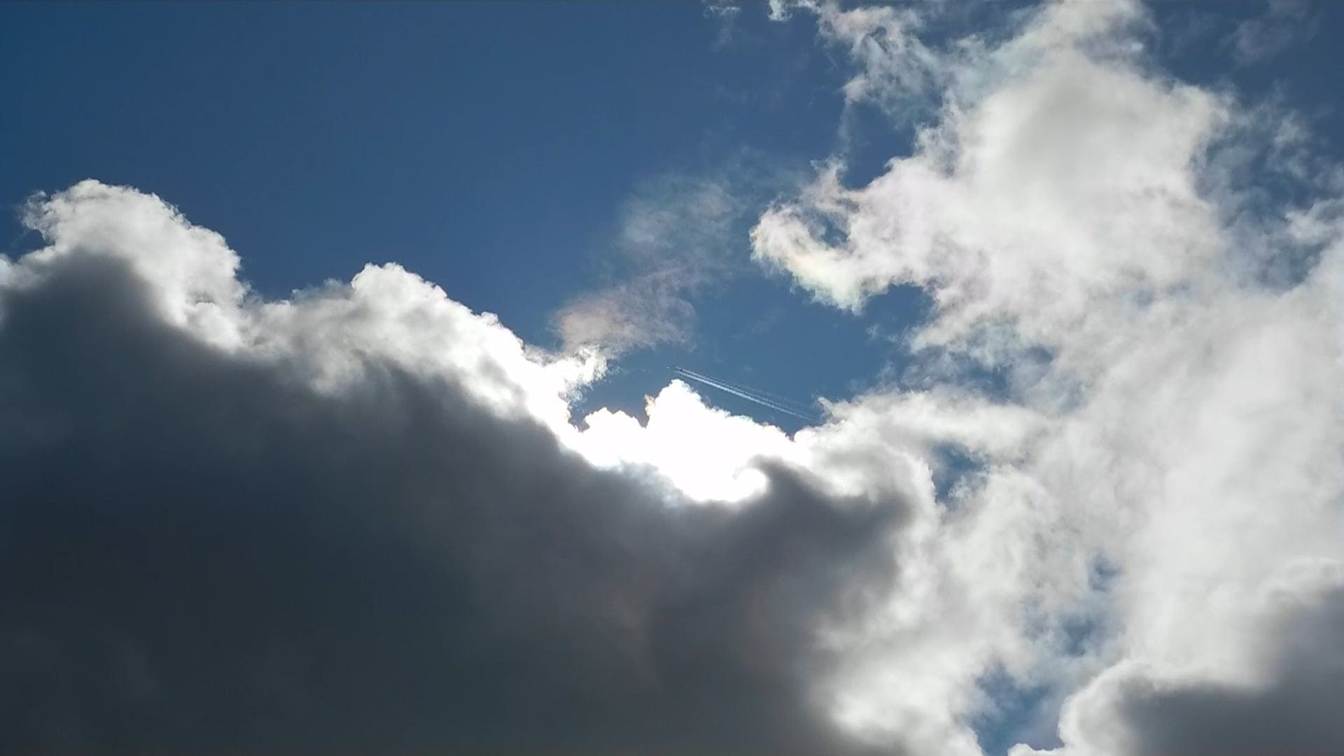 Jet On The Cloudy Sky