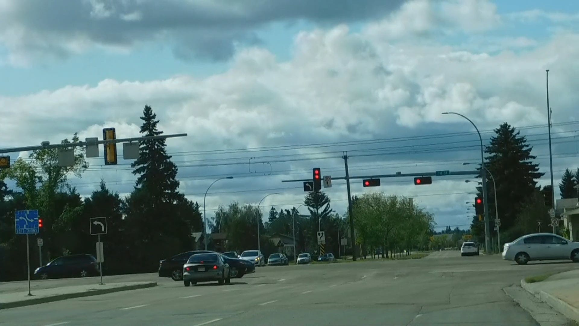 People Stopping At The Stop Light